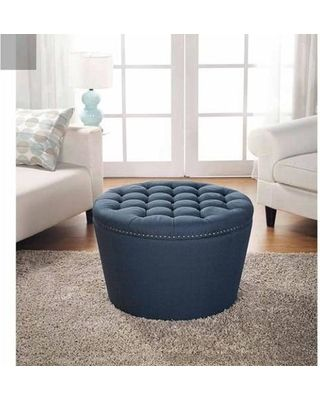 Bring a touch of versatile glamour to any room. The round tufted storage ottoman boasts a tapered base, a chic tufted top wrapped in lovely, linen upholstery and finished with nail head detailing. But more than just an eye-catching accent, this ottoman's top can be removed for storing household essentials inside.
