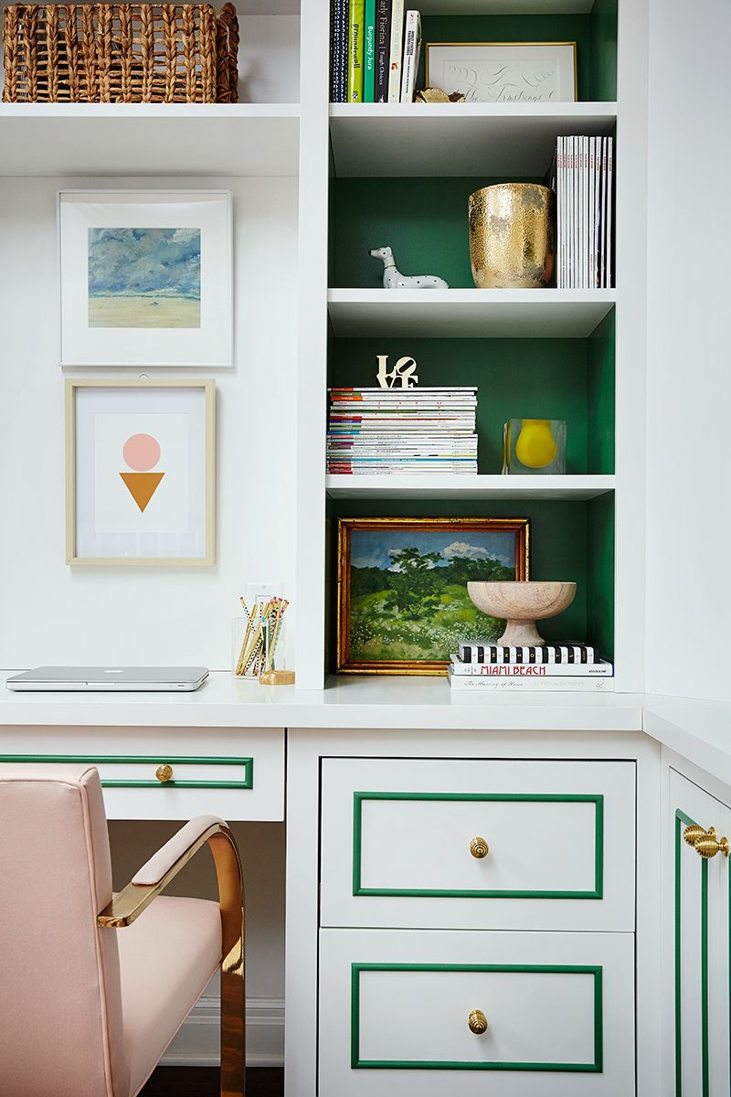 Painting inside of bookshelves love the green trim on the desk too