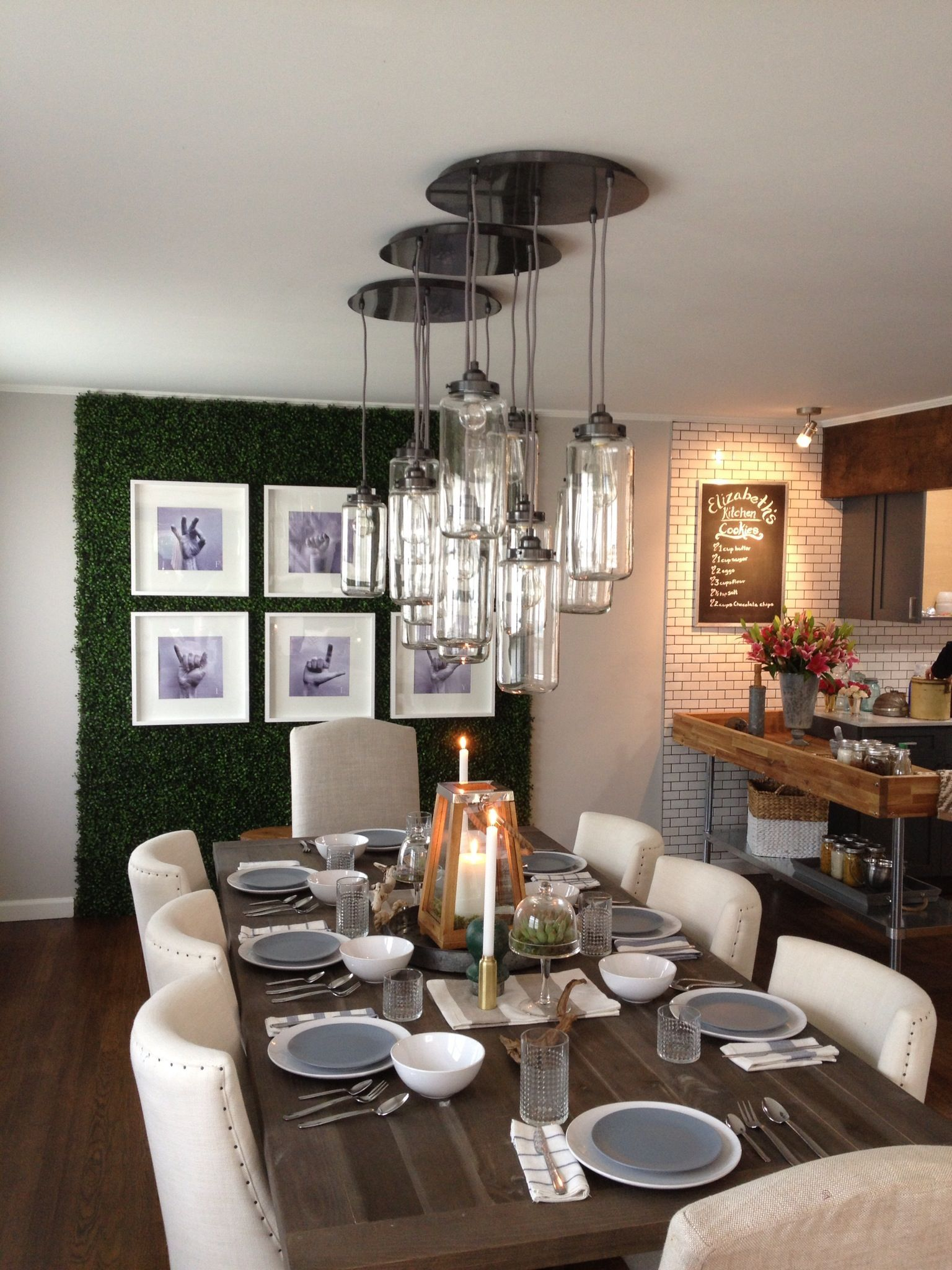 A large rustic table with a casual and fun light fixture for Casual dining lighting