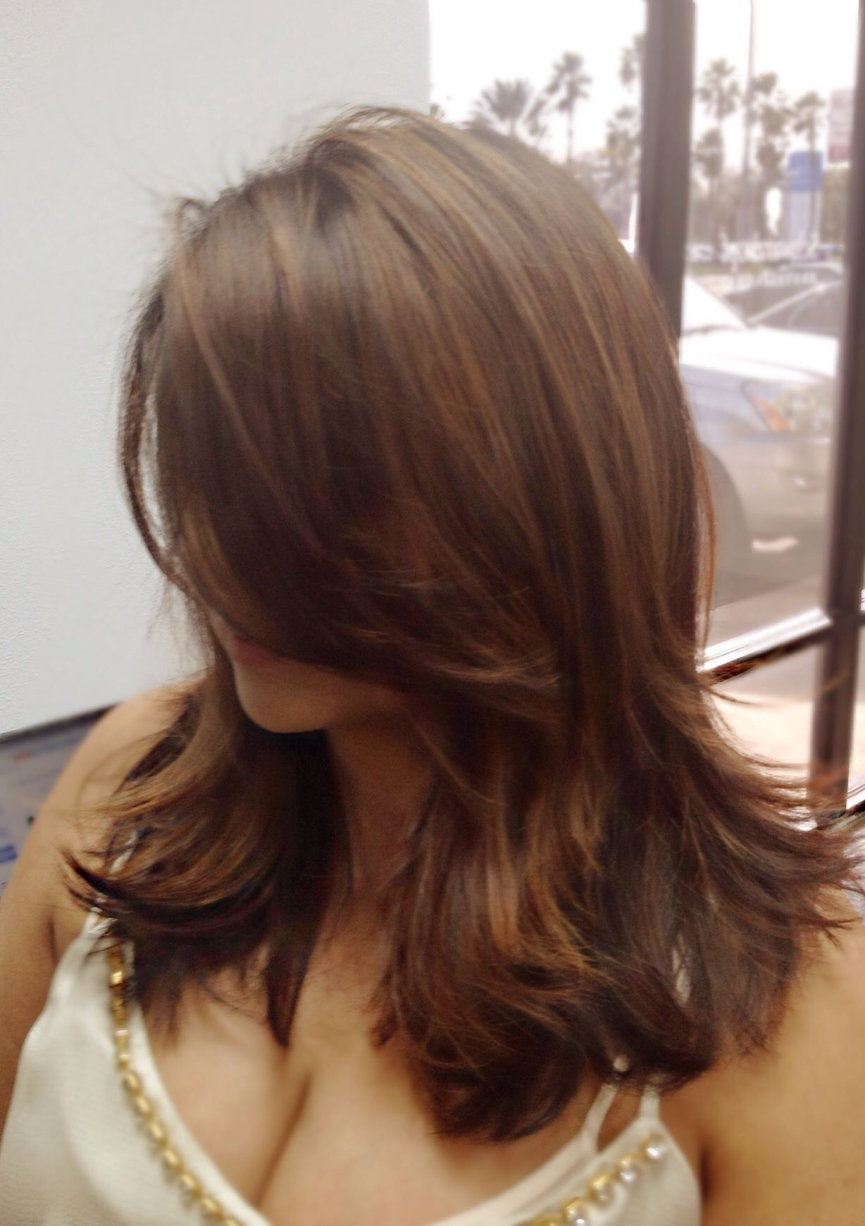brunette hair with midlength layered haircut