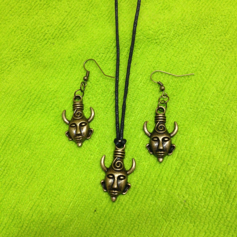 Supernatural pendant set with free matching keychain  https://www.etsy.com/uk/listing/225782487/supernatural-amulet-set