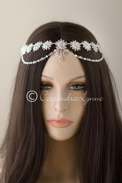 This beautiful headpiece is a head chain design of linked rhinestone flowers with ivory pearls.This Boho inspired bridal piece will make the perfect accessory a