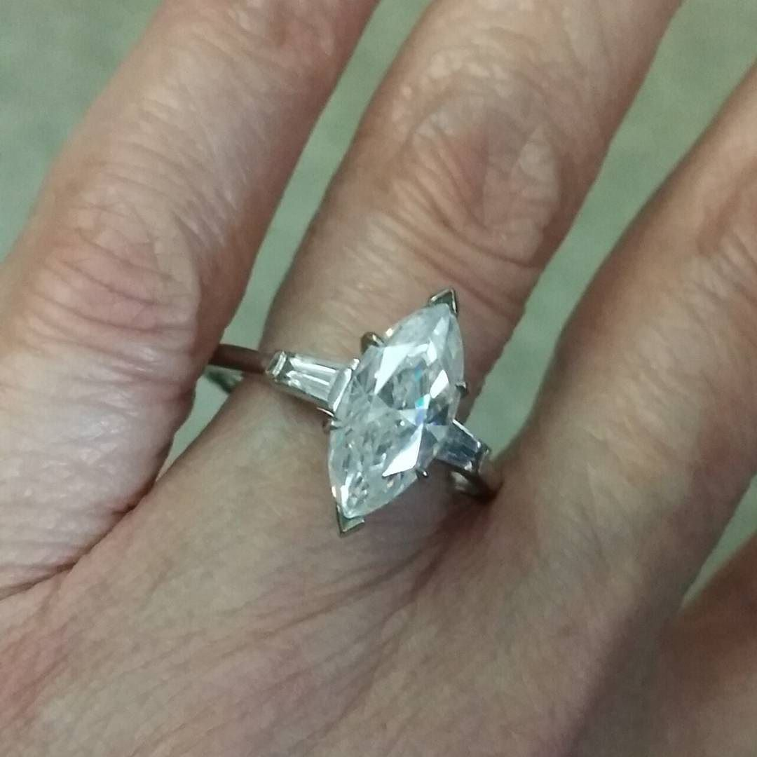 Gorgeous marquise cut ring with baguette accents all set in 14k white gold