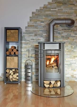 Burning Wood Fired Stove With Fire Irons And Fire Wood Freestanding Fireplace Wood Stove Fireplace Fireplace Design