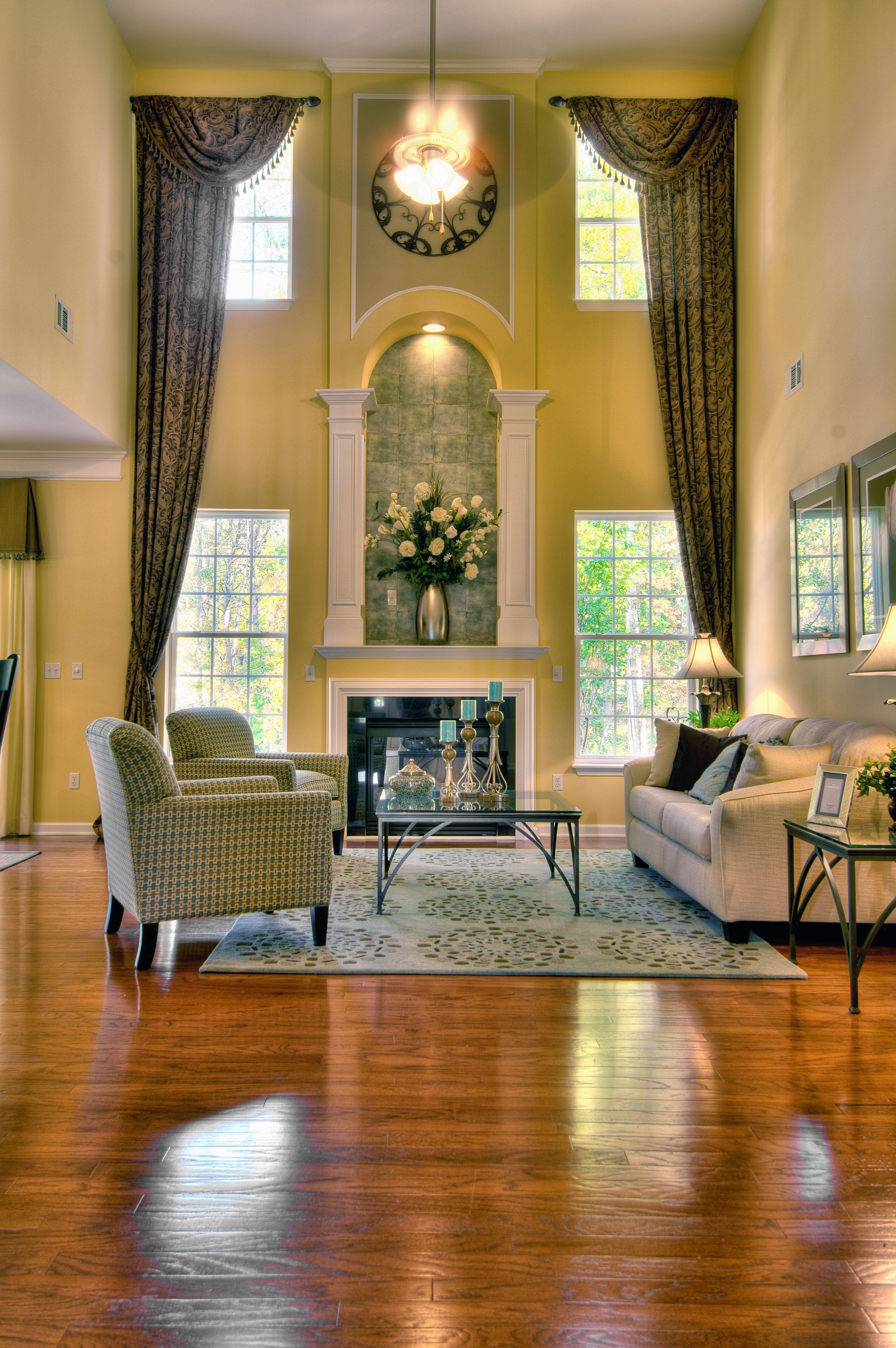 Dramatic Two Story Great Room From Eastwood Homes Building New Homes In North Carolina South Carolin High Ceiling Living Room Great Rooms Living Room Windows