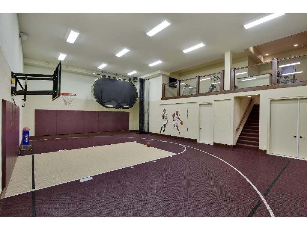 Carriage House Includes An Indoor Sport Court With A Basketball Hoop 3 Point Line An Exer Indoor Basketball Hoop Indoor Basketball Court Indoor Sports Court