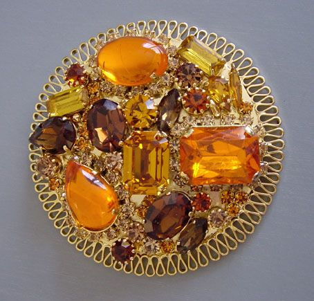 VRBA  topaz and yellow rhinestones and cabochons set in gold tone brooch,  3-1/2.