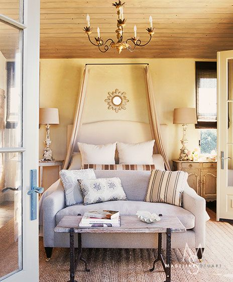 Guest room, idea for head board type of look, without the bulk of the actual headboard. Could easily change out the curtains, use sheets instead of curtains.