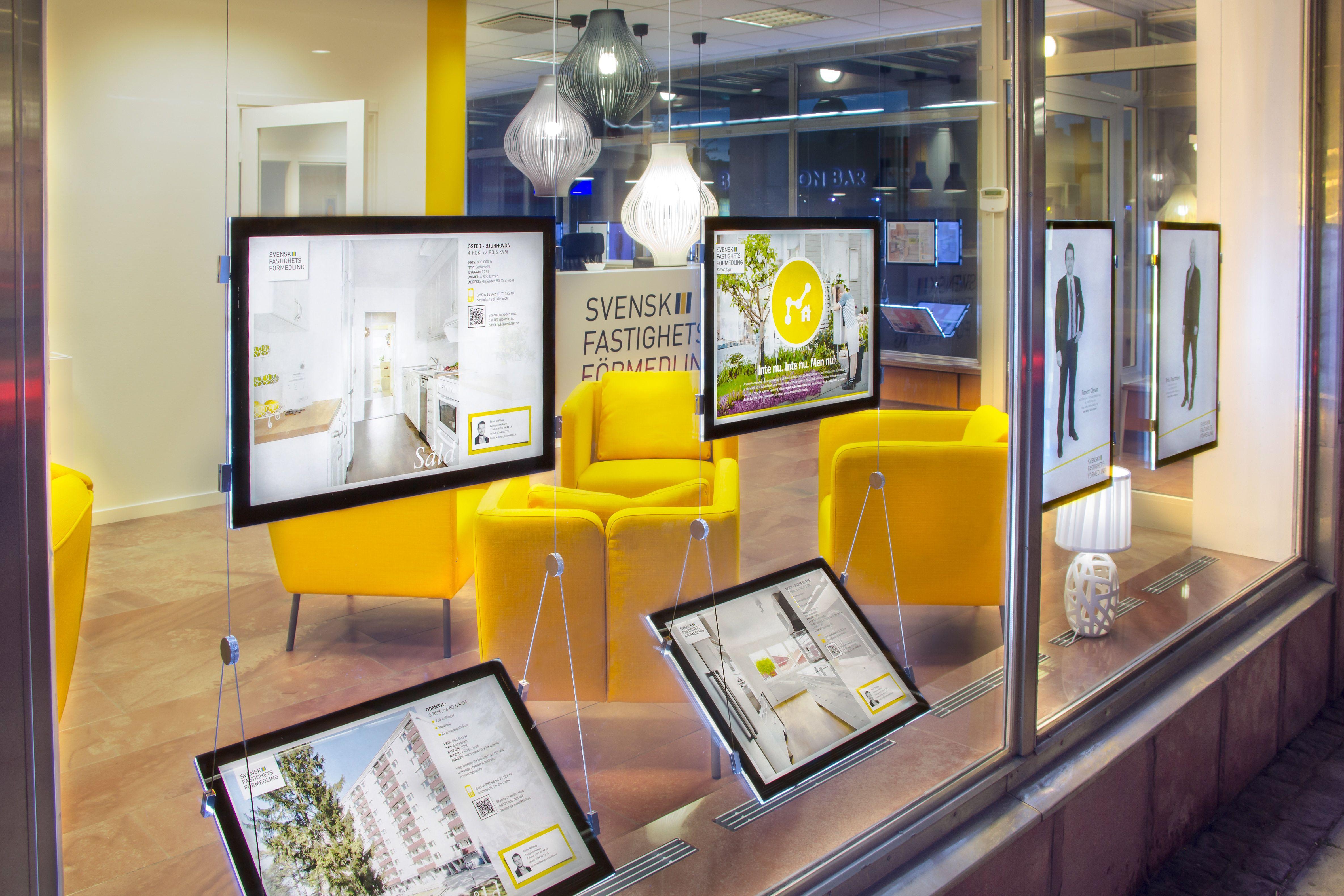 LED estate agent window display Office interior design