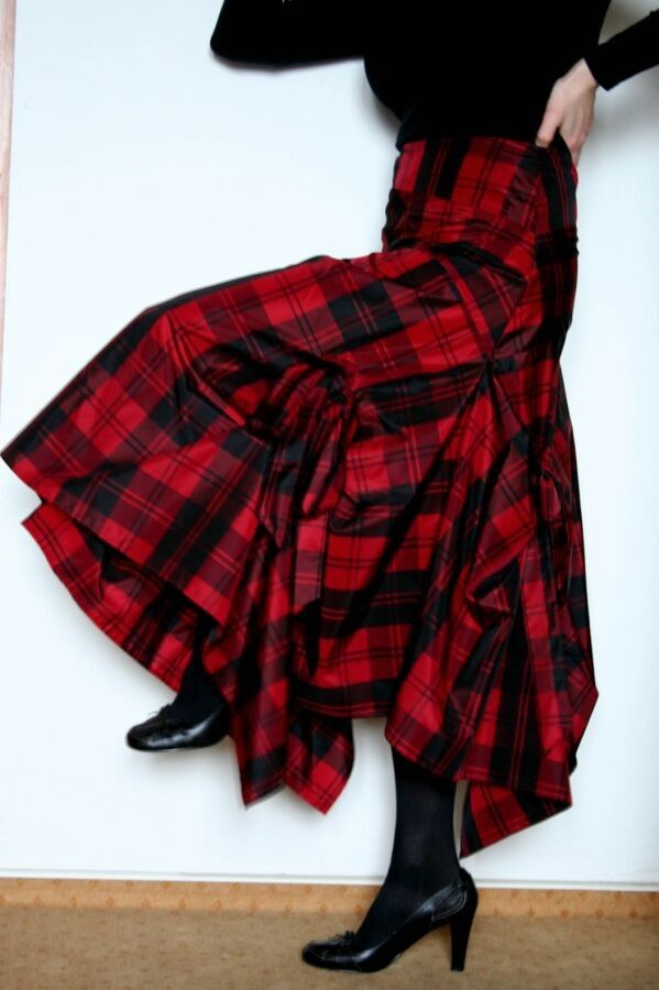 I know I should wear this warm sweater, long tartan skirt, wool stockings and boots, but I want to wear my new plaid short skirt........