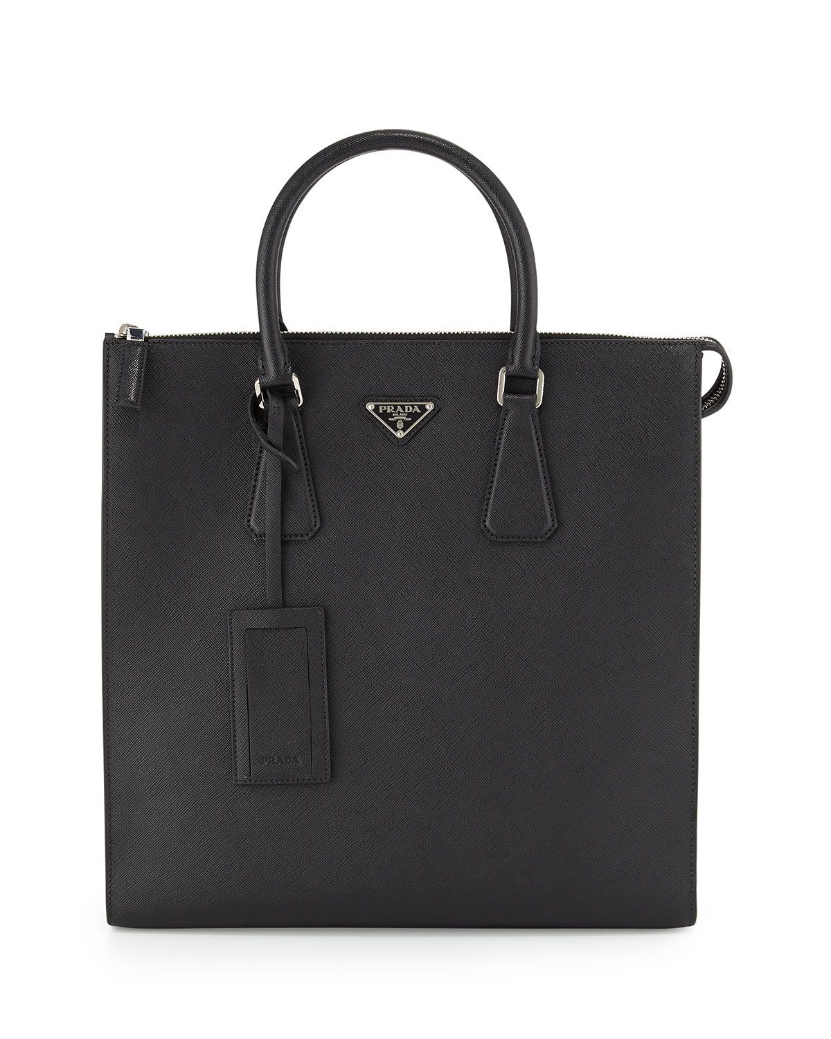 cba99f7cefc59 Prada tote bag in saffiano leather with polished steel hardware. Rolled  tote handles; logo-embossed hanging ID tag. Signature enamel triangle logo  at top ...
