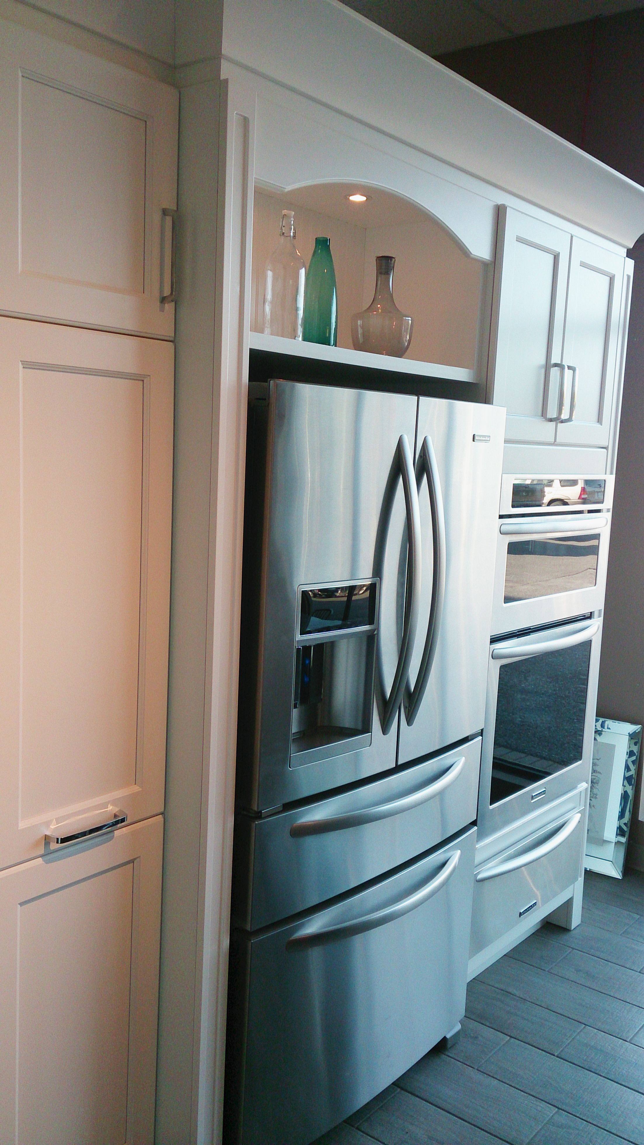 Open cabinet over fridge with bead board back, valance and lighting ...