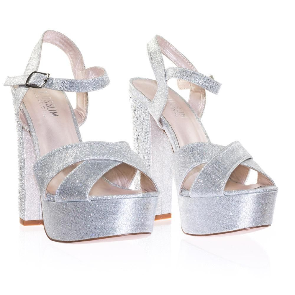 About This Shoes  These towering high sandal features a 6 inches chunky  block heel with assorted size rhinestone crystal jewel embellishments