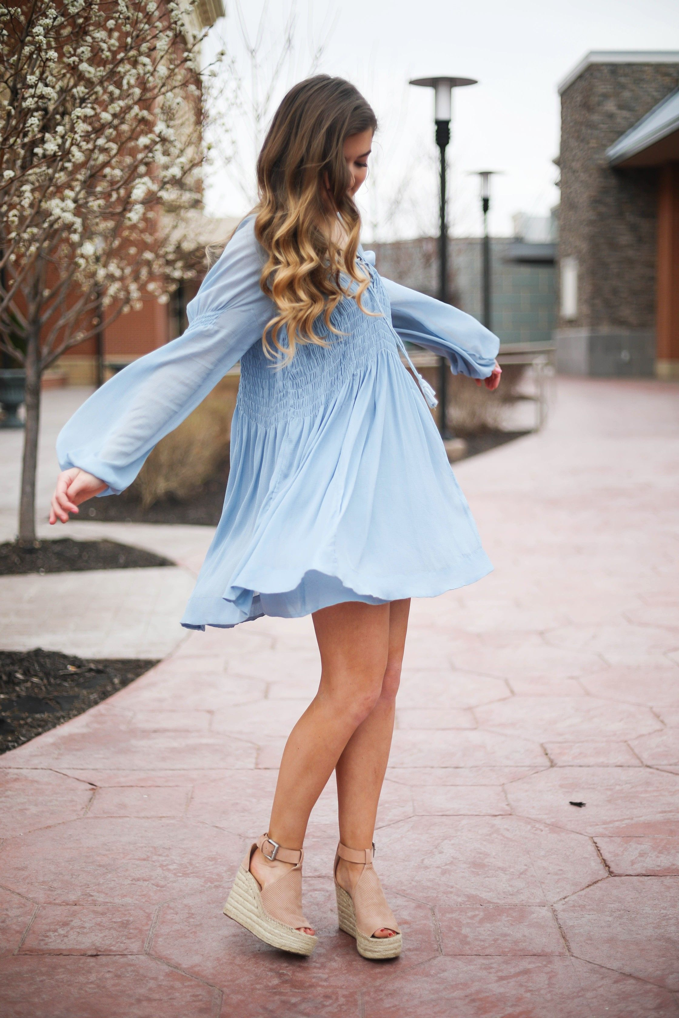 099dc158f61 The prettiest flowy light blue dress up on the blog! Paired with Marc  Fisher wedges and Lisi Lerch white tassel earrings. Details and links are  all on the ...
