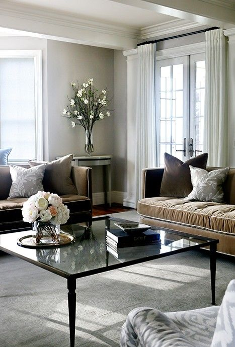 gray and brown living room features a pair of brown velvet sofas lined