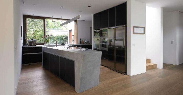 betonküche mit schwarzen schrankfronten und einbaugeräten | trends