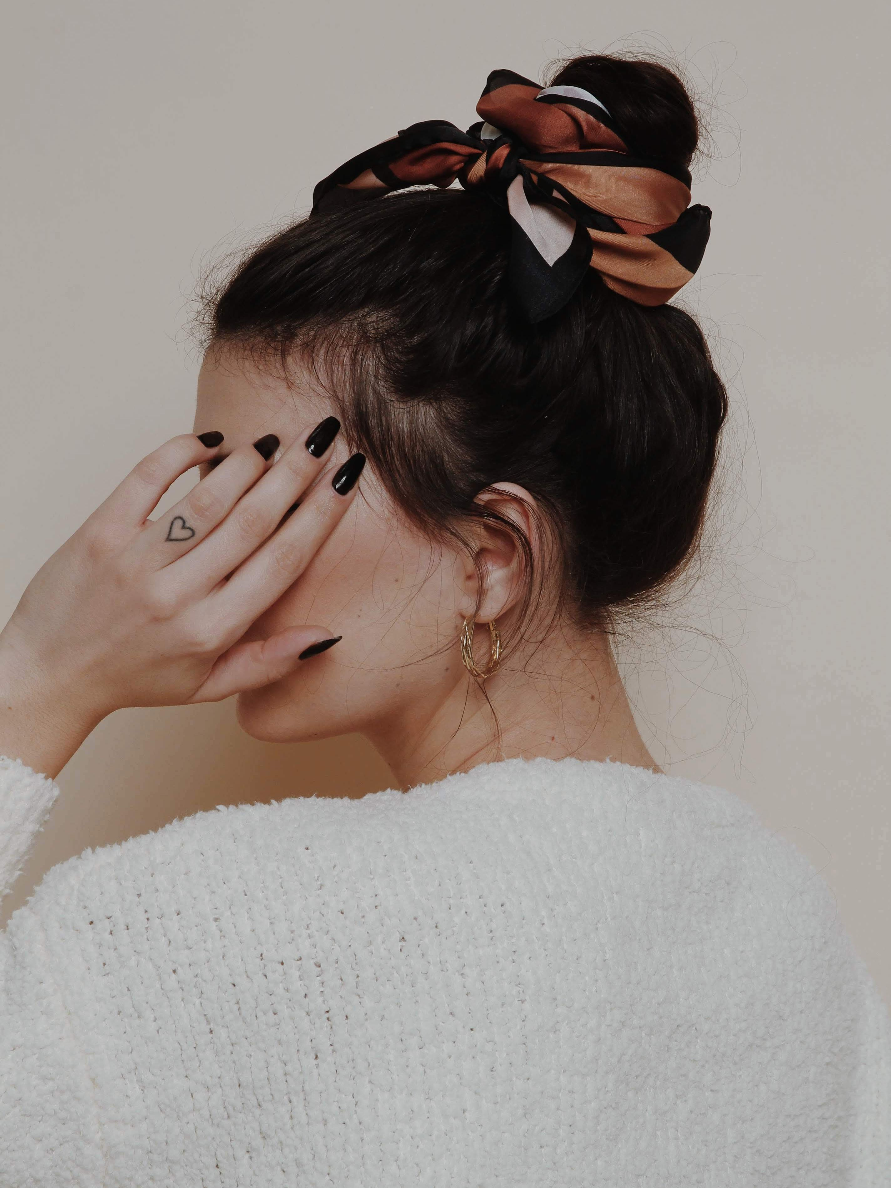 Hairstyle Idea And Inspiration Brown Scarf And Messy Bun