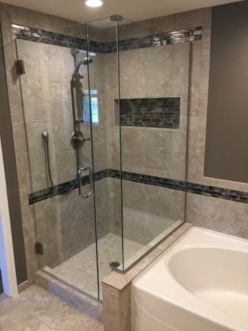 Framless, clear shower enclosure with brushed nickel ...