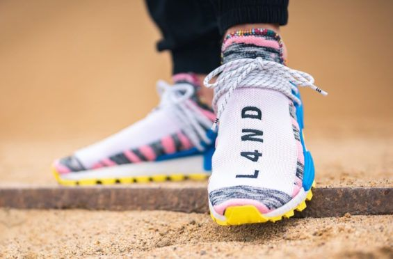 separation shoes 21239 8a874 The Pharrell x adidas NMD Hu Solar Light Pink Is Now Available Out of the  three