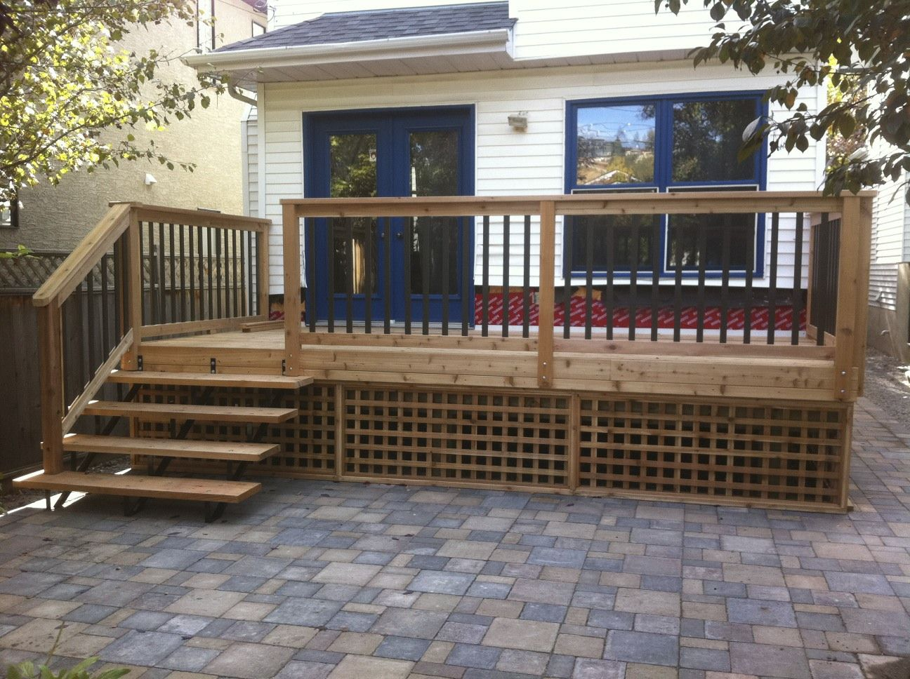 Cedar deck with custom built cedar and bronze aluminium for Custom deck ideas