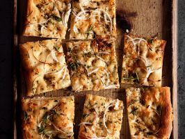Onion-Herb Focaccia : This impressive-looking appetizer is a snap to make, thanks to a shortcut ingredient: refrigerated pizza dough. Top it with rosemary-oregano olive oil and thinly sliced onions.