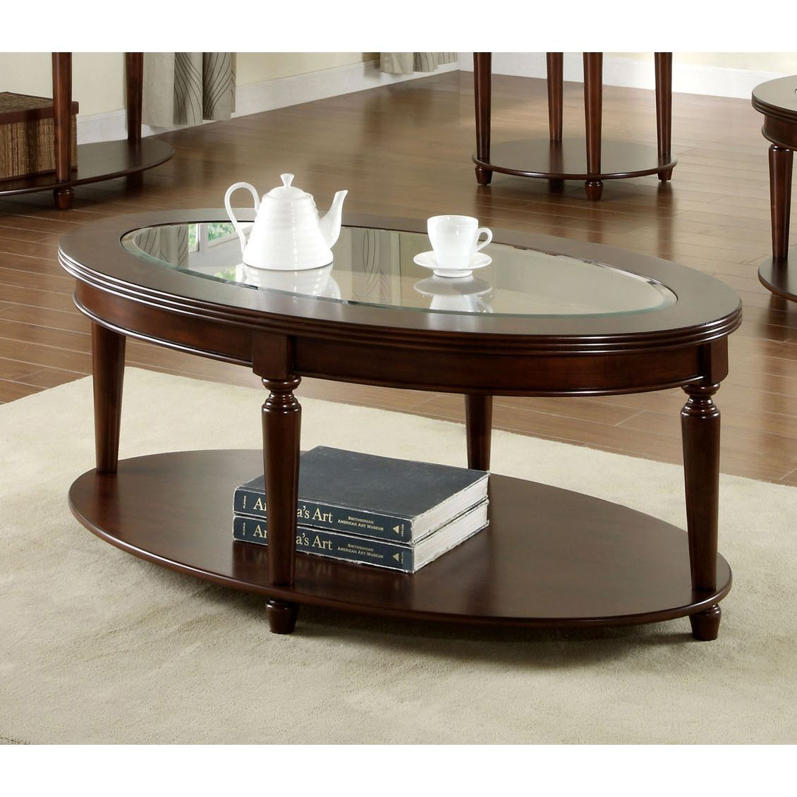 This Beautiful Coffee Table Features An Oval Shape And A Rich Dark Cherry Finish Elegant Turned Legs Ilize Handsome Piece While Supporting The
