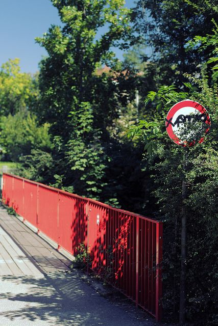 A red bridge in the people park in Graz, Austria. (With