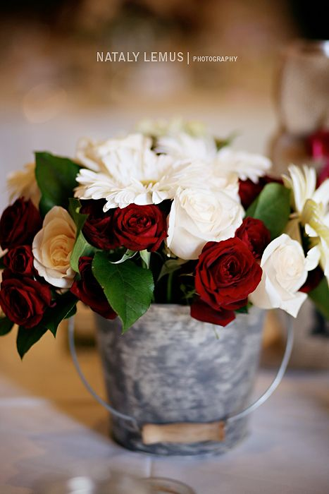 Red and white flowers and roses wedding centerpiece in a tin pail red and white flowers and roses wedding centerpiece in a tin pail bucket for rustic theme wedding via nataly lemus photography mightylinksfo