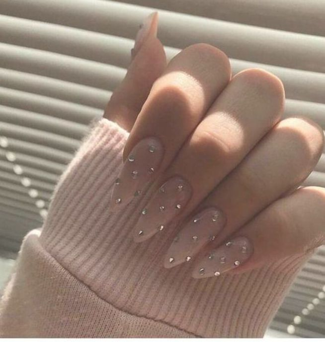 Photo of Long stiletto nails with glitter