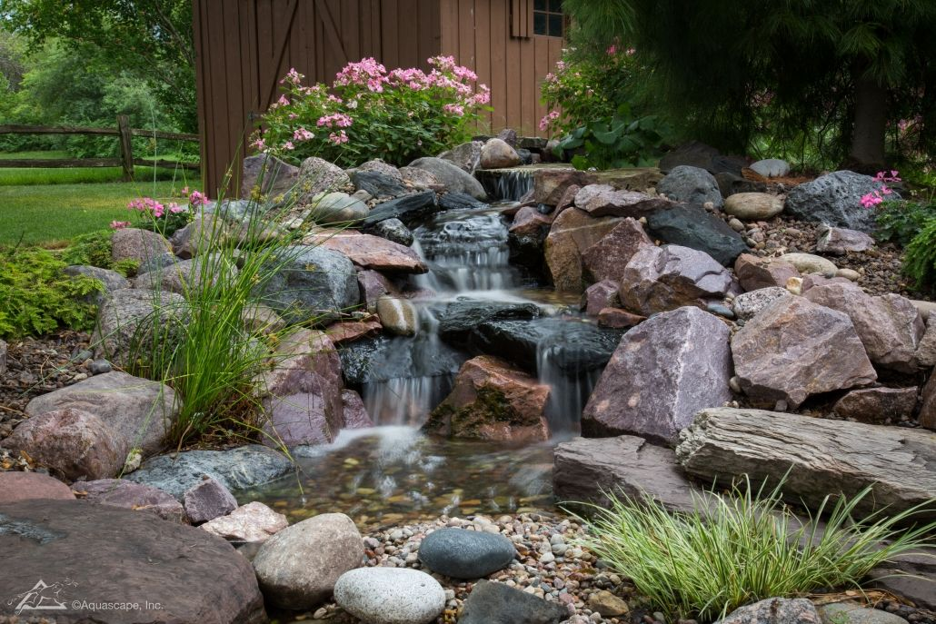 Pondless waterfall design construction fish pond