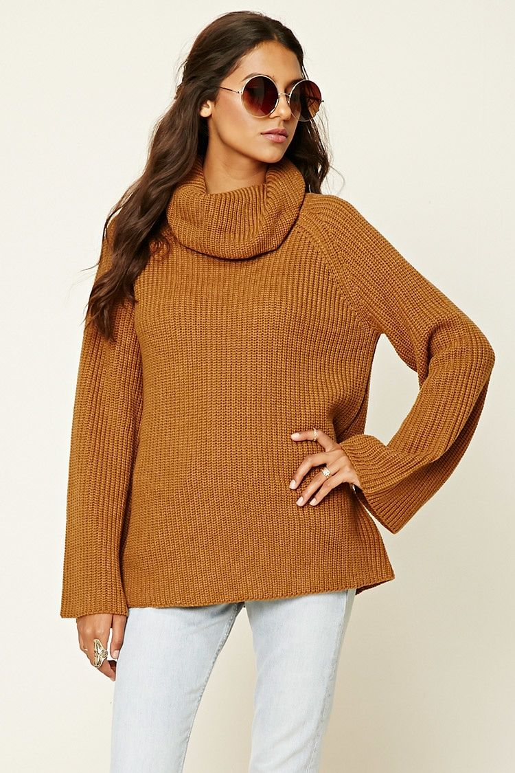 d38324955c A ribbed knit sweater featuring a cowl neck and long sleeves ...