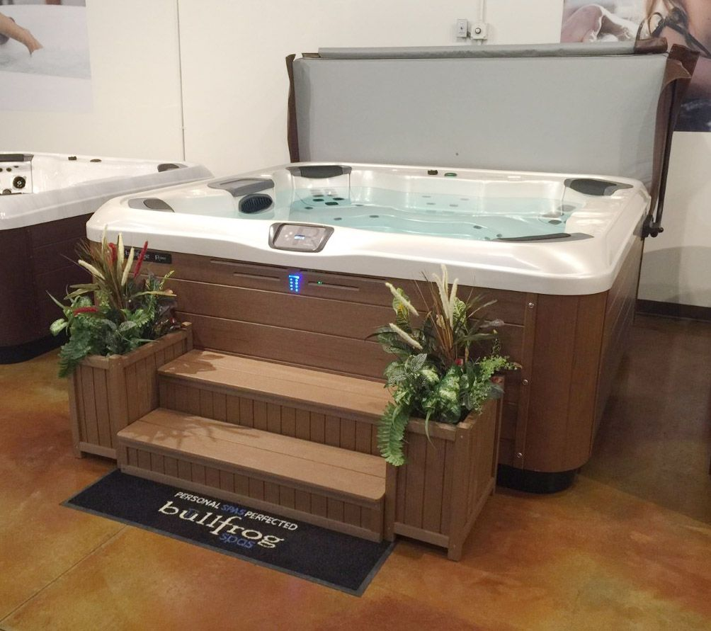 2 Tier Enclosed Step Lateral Tread With 2 Planters In Front Of A Bullfrog Spa Hdpe Hottubs Spas Bullf Hot Tub Accessories Hot Tub Backyard Hot Tub Steps