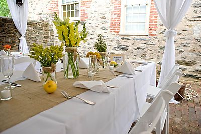 @Brittany Lane Burlap Table Runner With Yellow Flowers And White Table Cloth