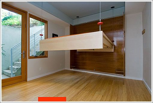 even better than a murphy bed a suspended bed that comes down from the ceiling