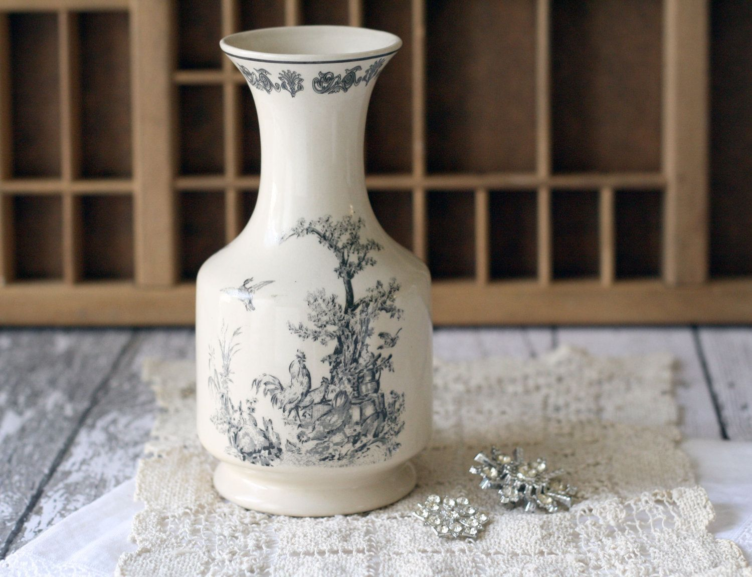 Vintage French Style Stoneware Carafe or Vase - Cream and Black Rooster Scene. $28,00, via Etsy.