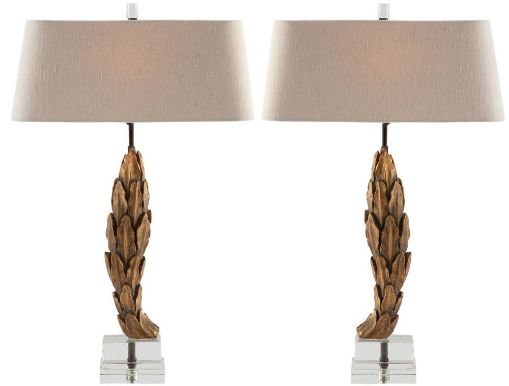 Gilded, carved laurel leaves give these charming lamps a sense of European sophistication fit for nobility   domino.com