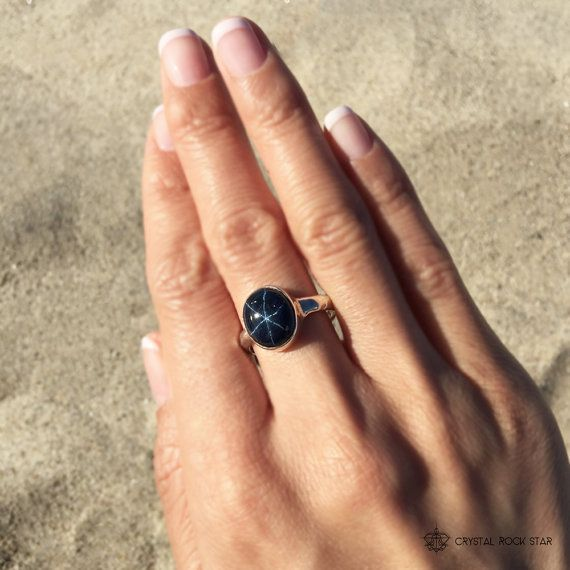 Fall in love with this genuine large blue star sapphire ring set in 925 sterling silver. The six pointed star in this blue sapphire comes from the refraction of light bouncing off the rutile inclusions in the crystal. Blue sapphire is a variety of corundum (aluminum oxide) that gets it's natural blue color due to the titanium and iron minerals in it's crystalline structure.  Wear this sapphire ring for energetic protection and to boost confidence and intuition.