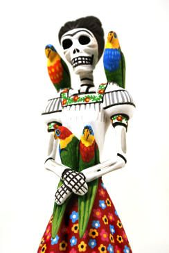 """Fantastic Frida Khalo catrina figure created by master carver Luis Pablo.  Luis Pablo is considered one of the top wood carving artists  in Oaxaca. He is one of the few Oaxacan carvers that makes everything himself...he designs, carves and paints all of his pieces.  This wonderful skeleton  is very nicely carved and painted... Frida has her traditional parrots, beautifully formed, she is wearing a typical peasant blouse and a lovely daisy long skirt.     A fantastic work of art!  12"""" Tall…"""