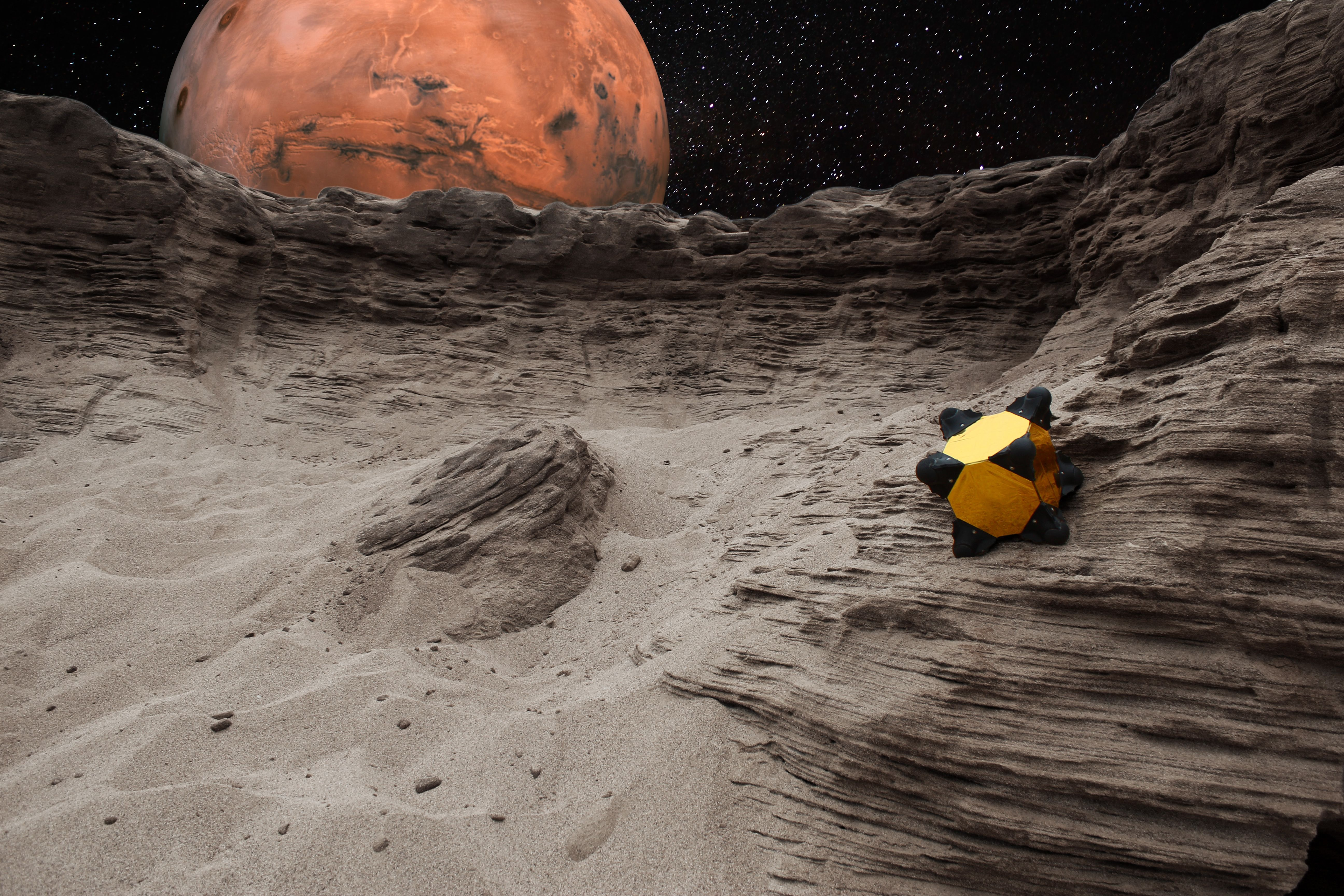"""While a Mars rover can't operate upside down, the Hedgehog robot can function regardless of which side lands up.  """"Hedgehog is a different kind of robot that would hop and tumble on the surface instead of rolling on wheels. It is shaped like a cube and can operate no matter which side it lands on,"""" said Issa Nesnas, leader of the JPL team."""