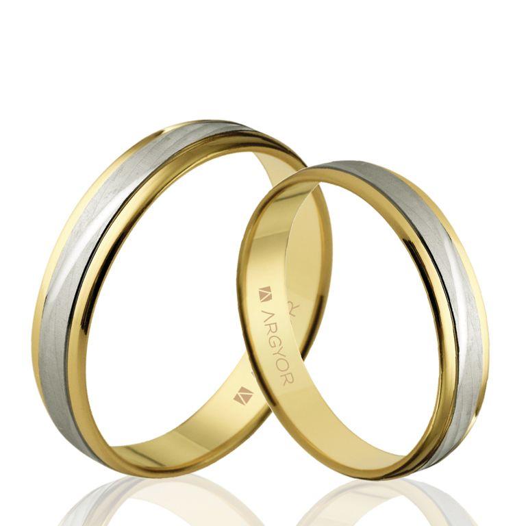 16df6480de38 Esta pareja de alianzas originales de Argyor son de oro 18k bicolor. Unos  anillos de boda perfectos para sellar vuestro amor.