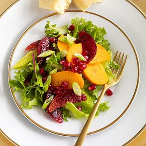 The brightly-colored fruit set against the dark leafy greens makes this stunning side salad perfect for your holiday meal.