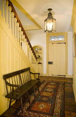 FARMHOUSE – INTERIOR – early american decor inside this vintage farmhouse entry hall seems perfect, designed by archer and buchanan architecture, ltd.