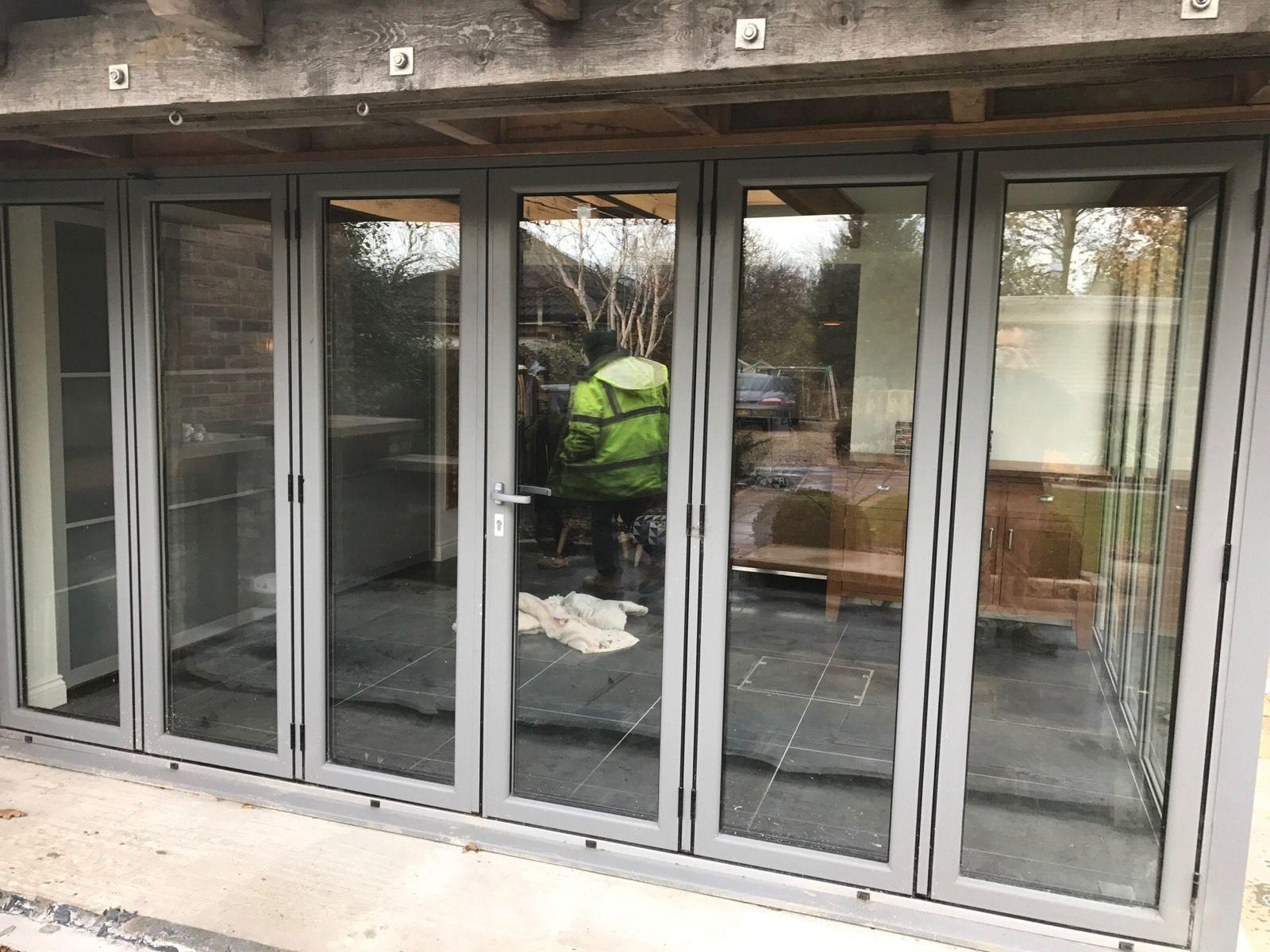 one set of powder coated aluminium bifold doors grey double glazed folding sliding doors