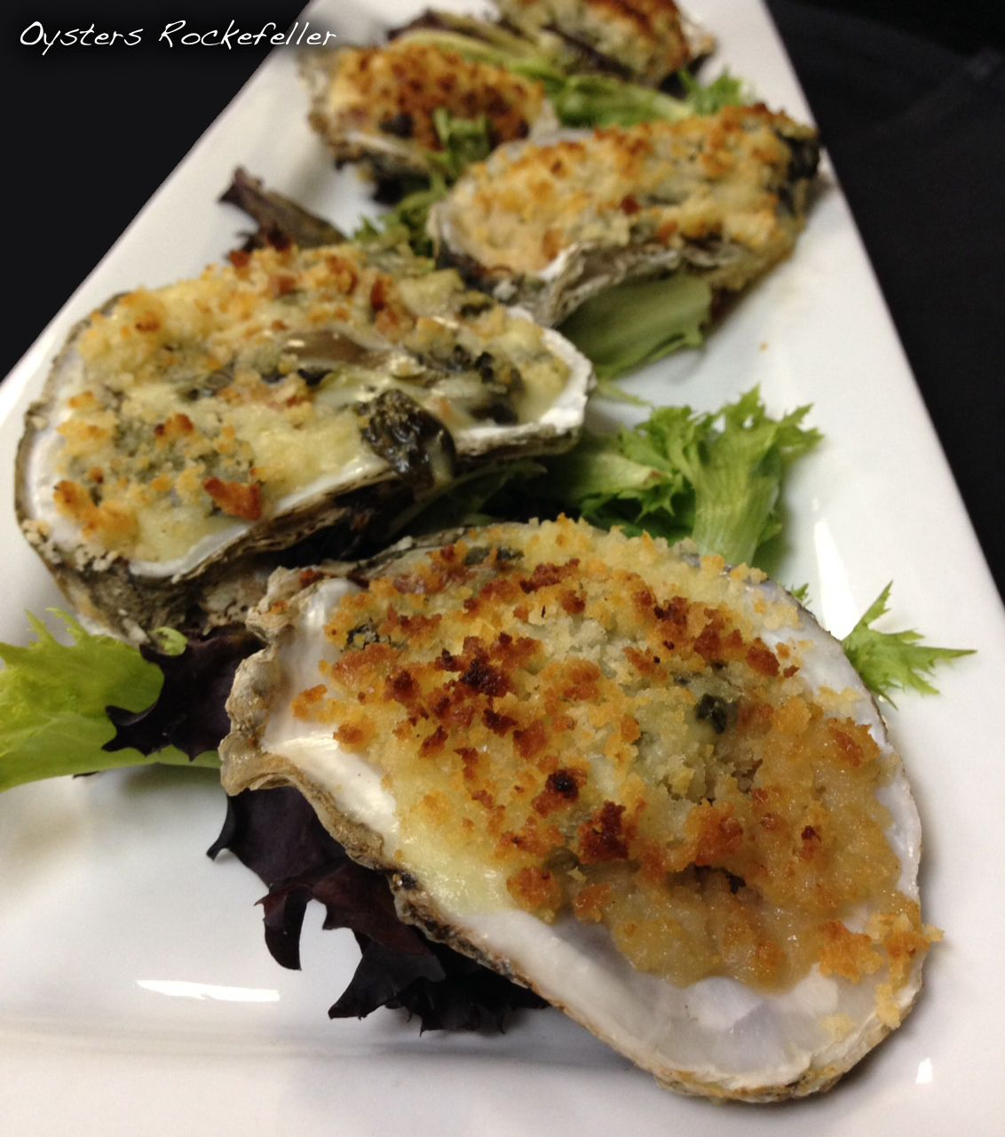 Oysters Rockefeller Oysters on the half shell topped with