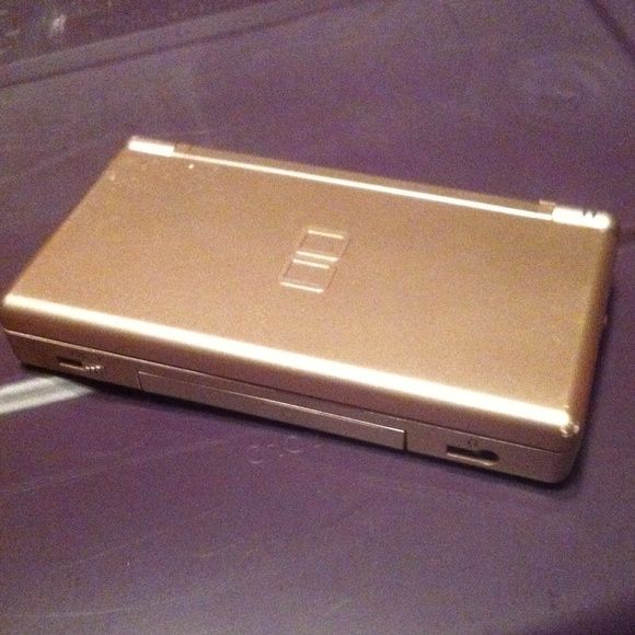 Metallic Pink Nintendo DS Lite. Great condition. Only flaw is a few surface scratches and the top screen bends back further than normal due to a broken hinge. This Includes the console, the cord, a game and the styles. Other