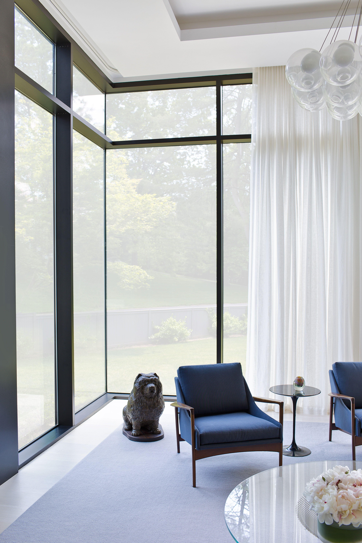 Mid century modern interior mcm armchair large windows living room