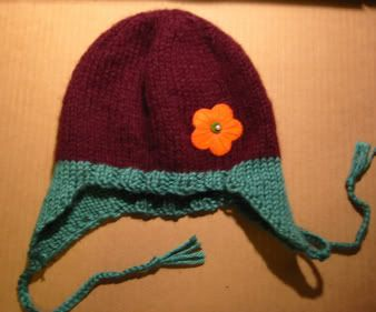This simple ear flap hat knits up quickly and will keep ...