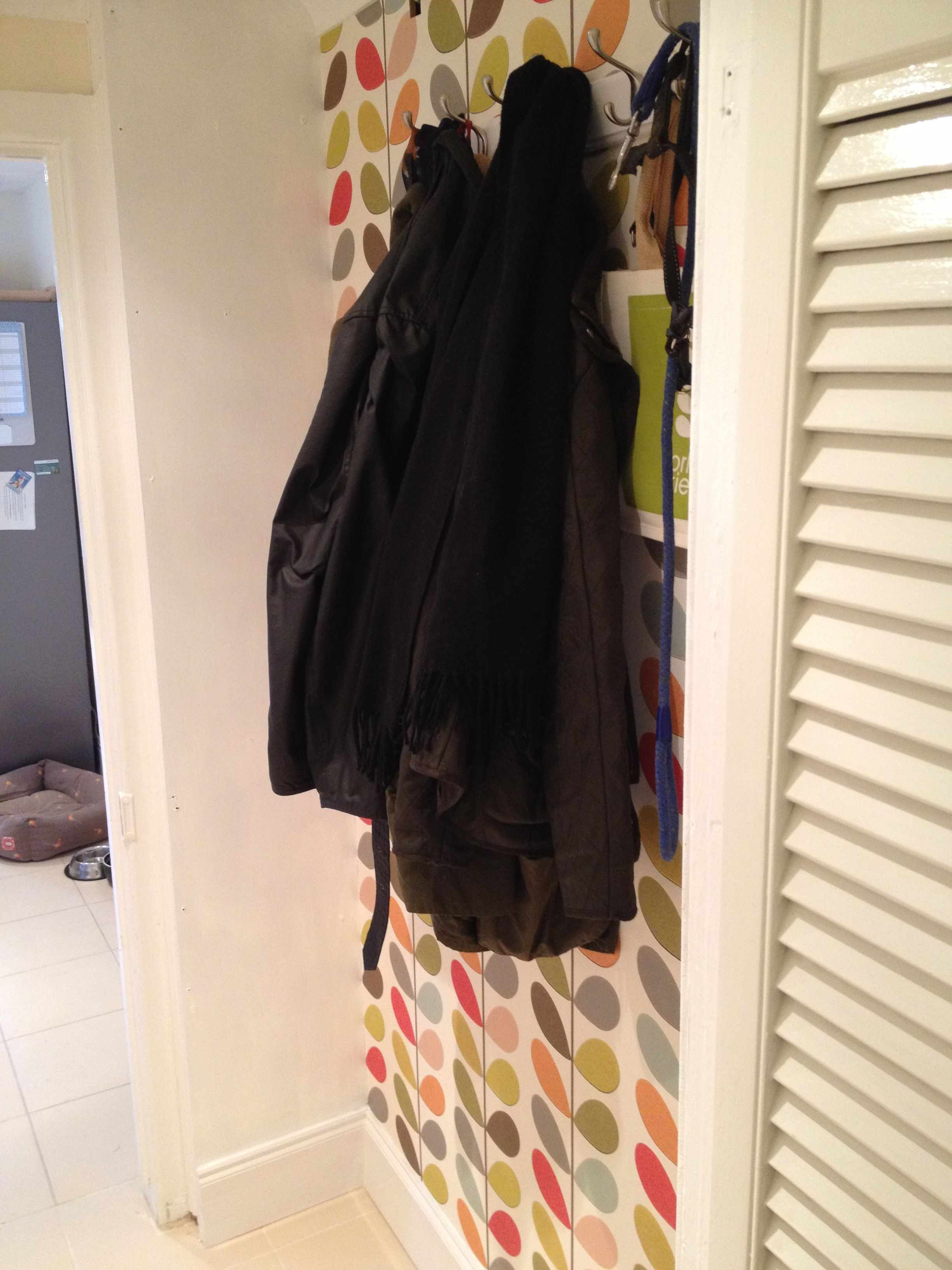 Bright hallway wallpaper  Handy coat hanging area in narrow hallway made bright and colourful