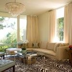 elizabeth dinkel, sheel lmap, pendant, chandelier, zebra rug, living room, tudted mint chairs, black piping, glass walls, long windows, holl...