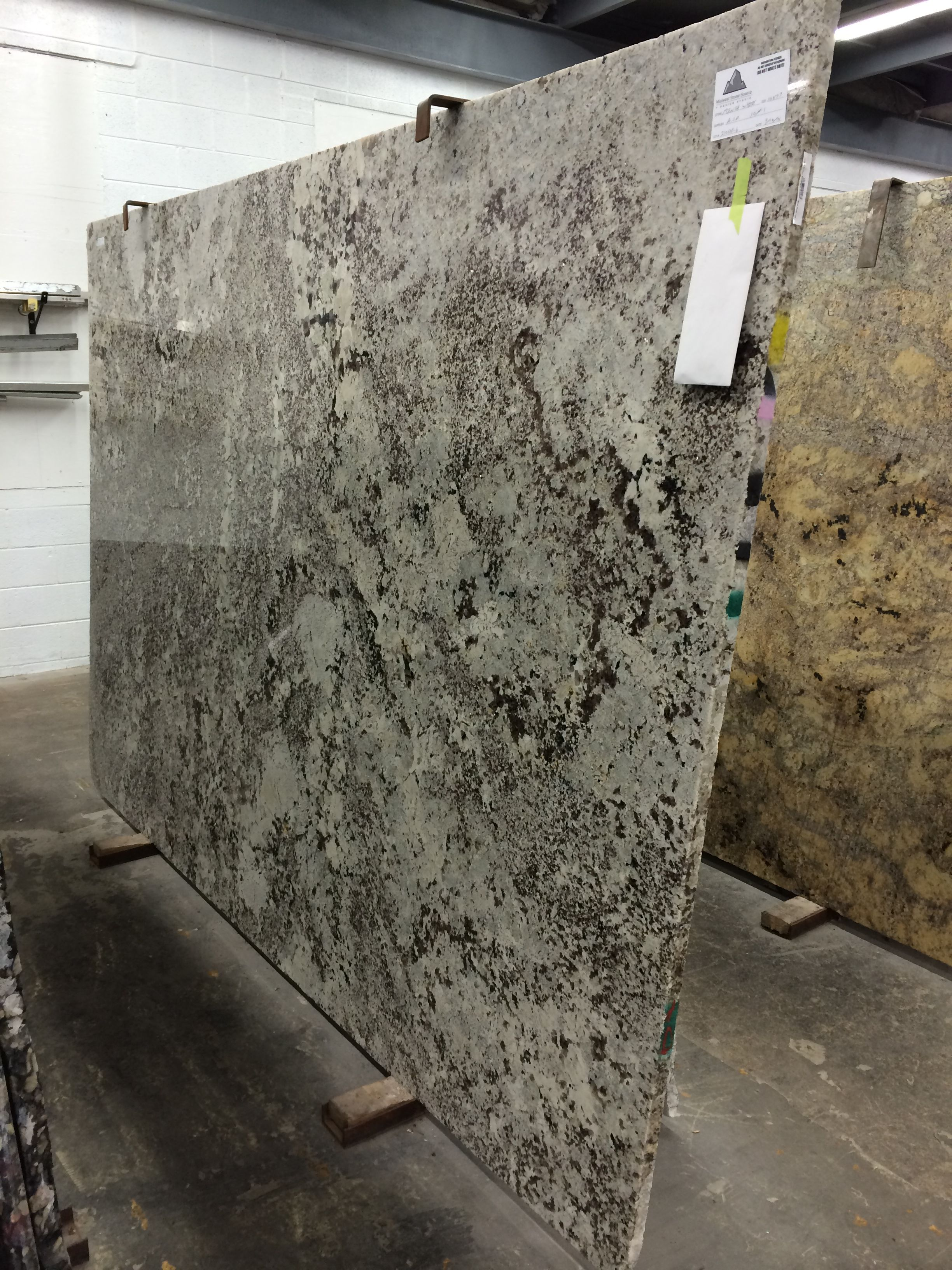 Charming Minsk White Granite Is A Stunning Piece With Rich Colors And Beautiful  Texture That Would Complement